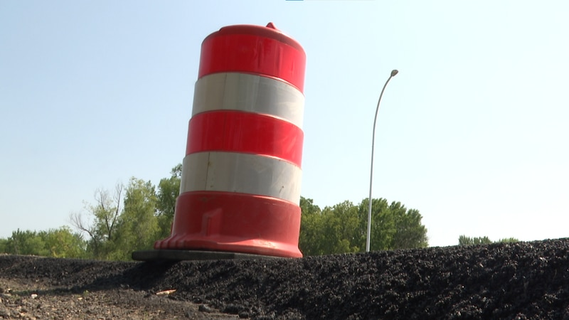 A construction barrel is pictured Thursday, July 15, 2021, in Madison Lake, Minn.
