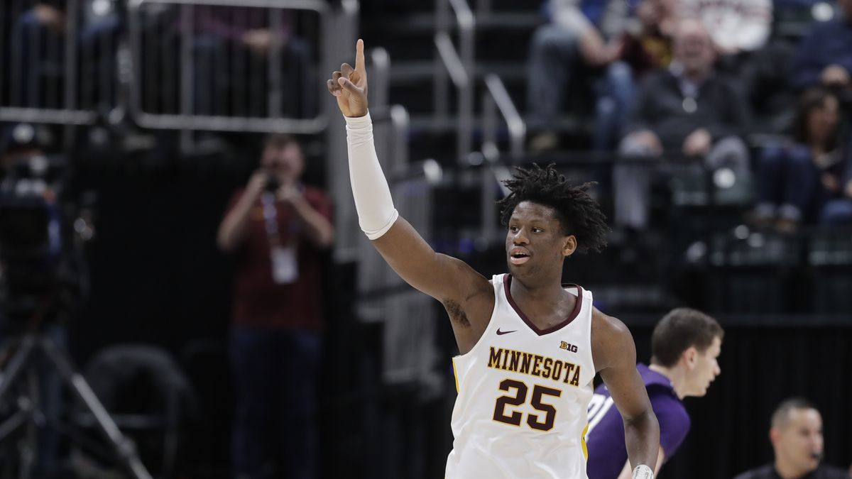 Minnesota's Daniel Oturu (25) reacts during the second half of an NCAA college basketball game...