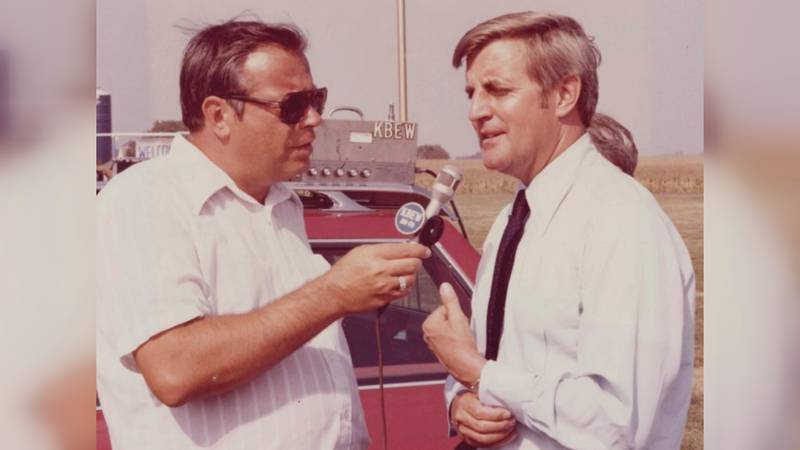 FILE — Paul Hedberg, left, interviews a man during a KBEW radio broadcast in this undated file...