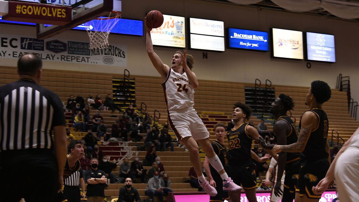 FILE — Parker Fox (24) lays in a finger-roll against the University of Minnesota Crookston in...