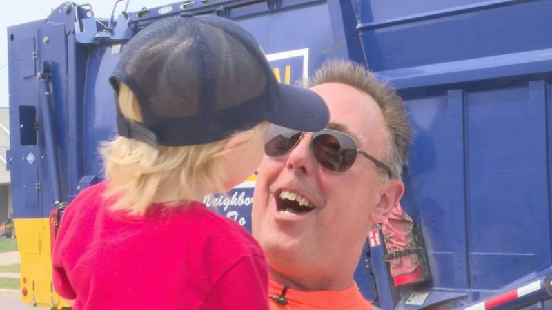 Jeff Weber lifts 2-year-old Elliot Witte Thursday, July 29, 2021, in North Mankato, Minn. Witte...