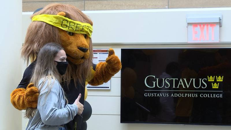 First-year student poses on Move-In Day at Gustavus Adolphus College.