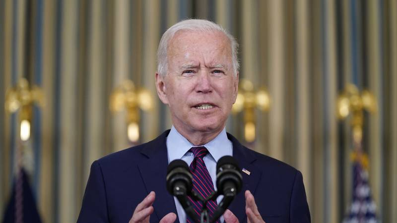 President Joe Biden delivers remarks on the debt ceiling during an event in the State Dining...