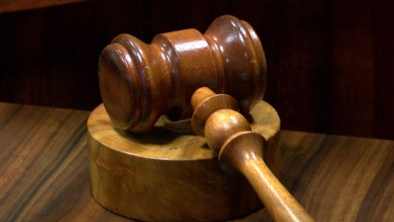 FILE — A Canadian man has pleaded guilty to transporting 67 illegal guns in a rented truck that...