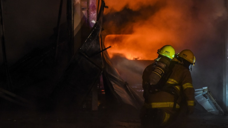 FILE — Firefighters battle a blaze at a private residence at Restless Court that broke out...