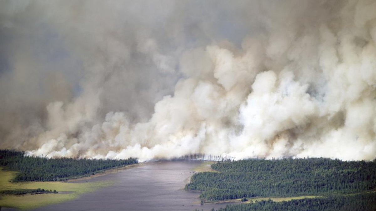 As the Greenwood Fire continues to burn, smoke from the blaze fills the air near Slater Lake as...