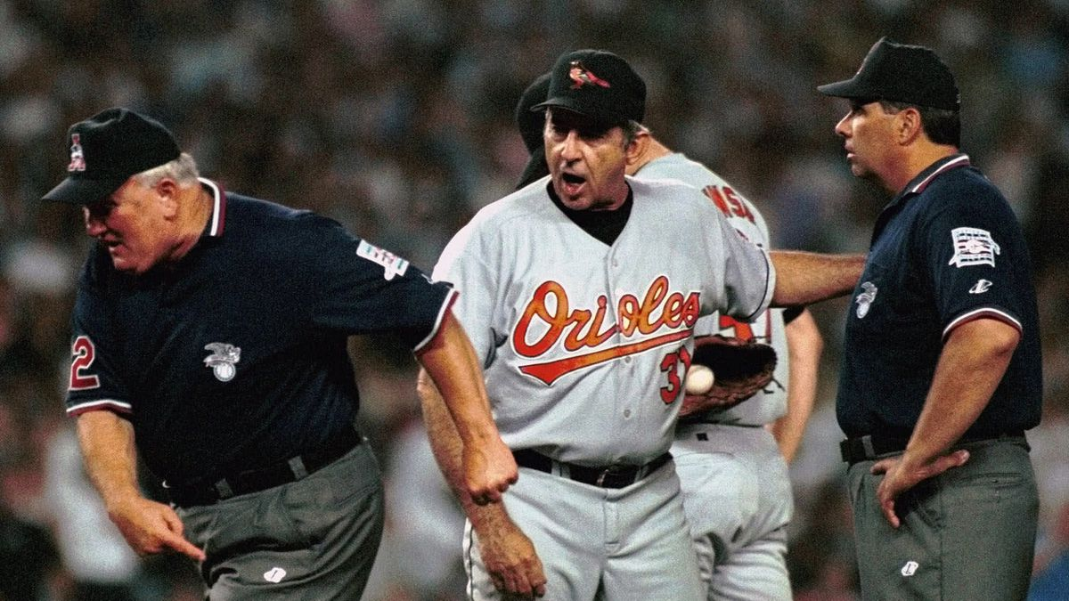 FILE - In this Friday, July 2, 1999 file photo, Baltimore Orioles manager Ray Miller, center,...