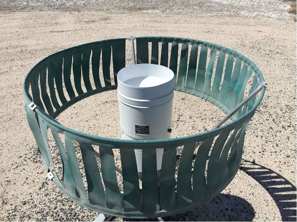Example of what a heated tipping bucket precipitation gauge looks like. The green screen you...