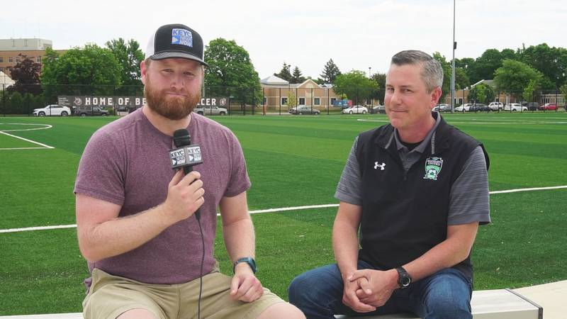 KEYC News Now Sports Director Rob Clark, left, speaks with Mankato United Soccer Club general...