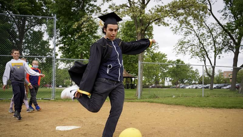 John Sadaka, a graduate of Mankato East High School, plays kickball with elementary students...