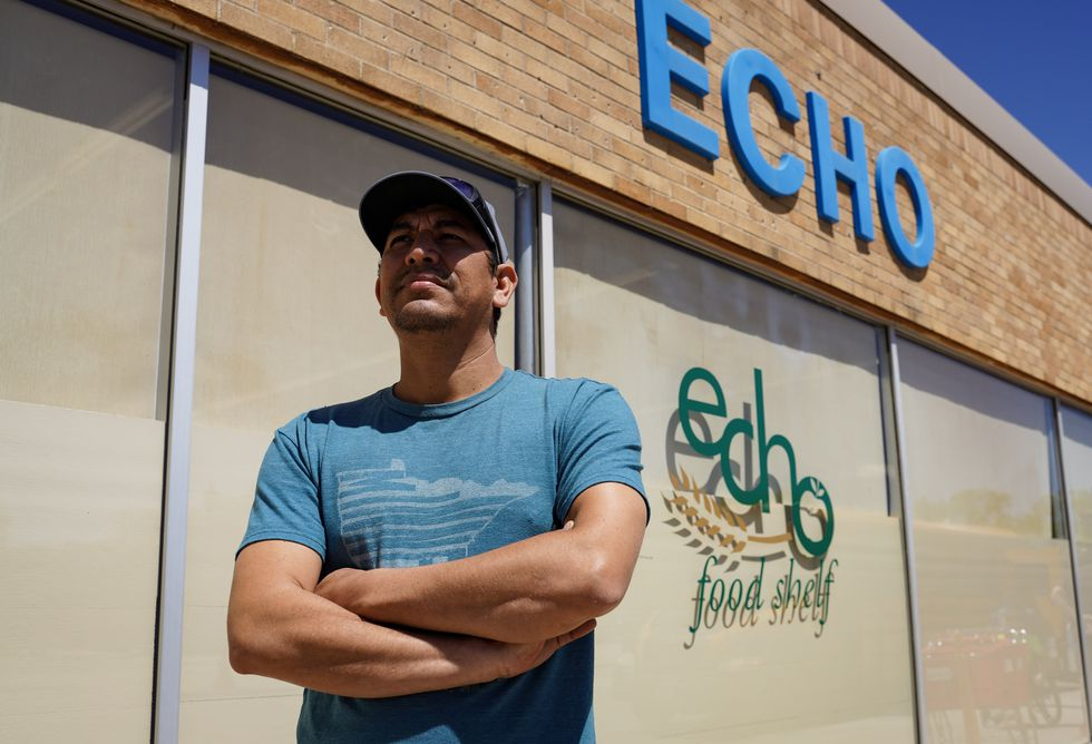 Adam Deleon poses for a portrait outside ECHO Food Shelf after making a delivery to the...