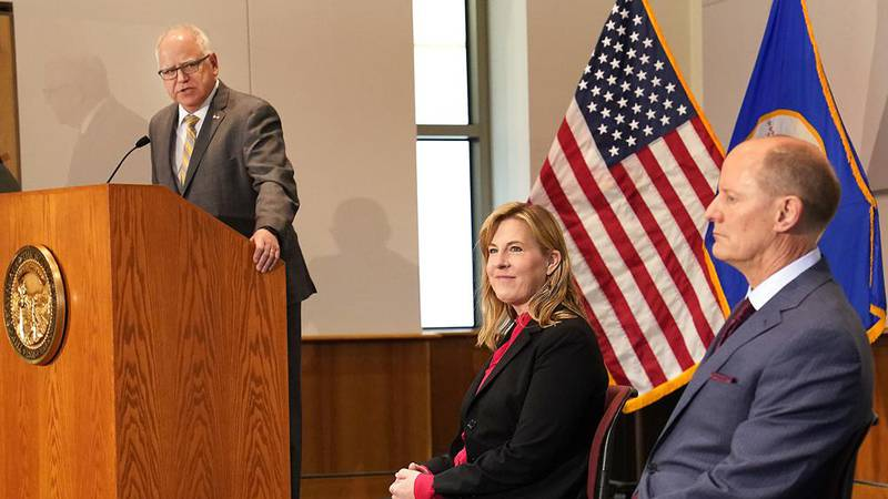 Minnesota Gov. Tim Walz speaks at a podium as Senate Majority Leader Paul Gazelka, R-East Gull...