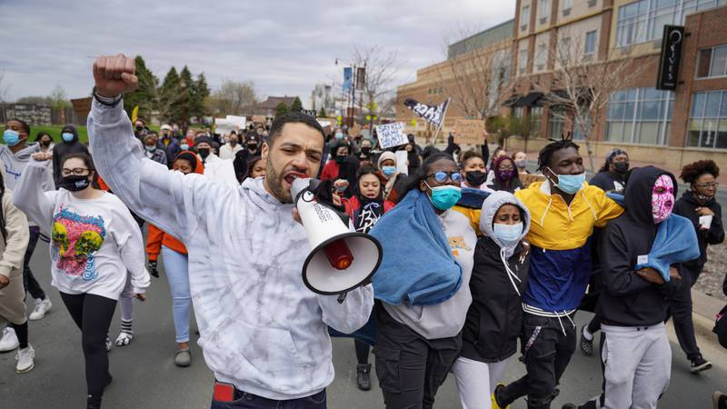 Demonstrators march through Mankato calling for justice in the shooting of Daunte Wright ,...
