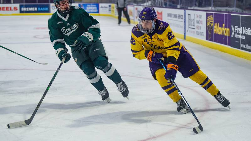 Minnesota State University, Mankato forward Dallas Gerads works the puck up the rink during a...