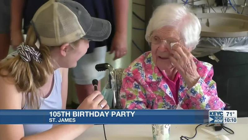 Irene Sandeo, right, celebrates her 105th birthday with friends and family in St. James, Minn.