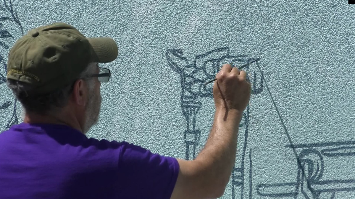 Artist adds finishing touches on mural in St. James