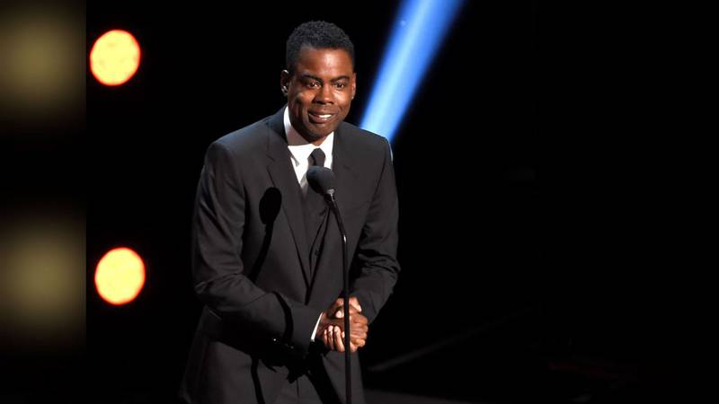 FILE - In this March 30, 2019 file photo, Chris Rock presents the award for outstanding comedy...