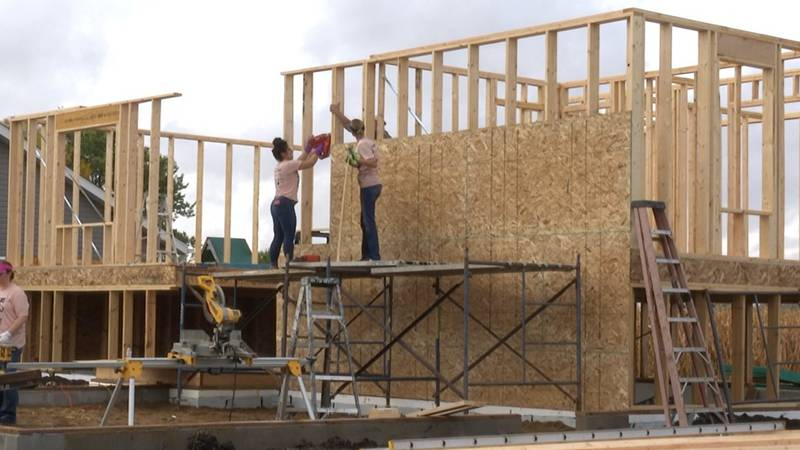 Pioneer Bank's team of women work on building a home for Habitat for Humanity in Nicollet, Mn.