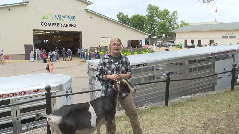 Zoe Johnson stands with her goat, Beatrice, at the Minnesota State Fair.