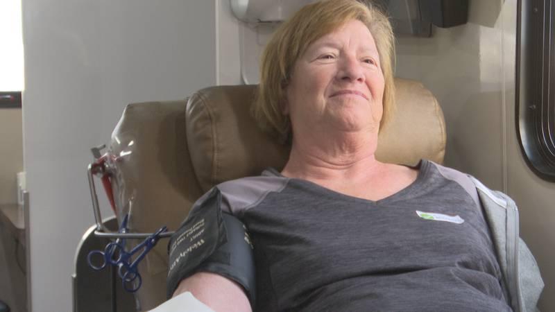 Dona Olsen donates blood at Windom Area Health.