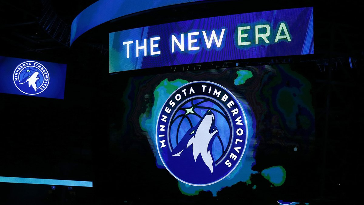 A new Minnesota Timberwolves logo is unveiled on the scoreboard during halftime of the team's...