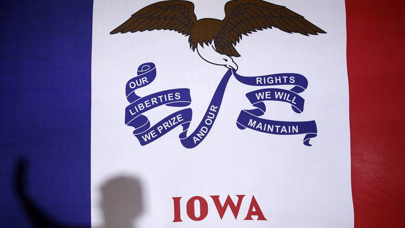 Democratic presidential candidate Sen. Elizabeth Warren, D-Mass., casts a shadow on an Iowa...