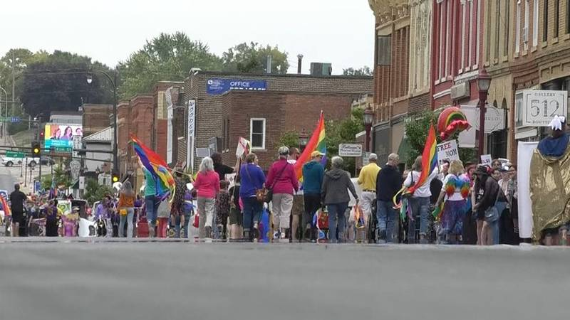 People walk down Riverfront Drive at Mankato PrideFest parade in 2019.