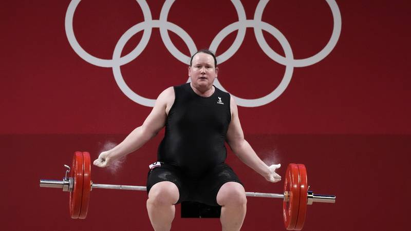 Laurel Hubbard of New Zealand drops the barbell during a lift in the women's +87kg...