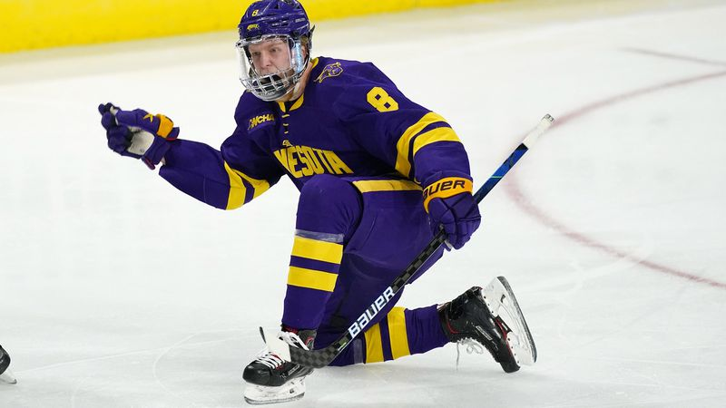 Minnesota State forward Nathan Smith celebrates after scoring a goal against Minnesota in the...
