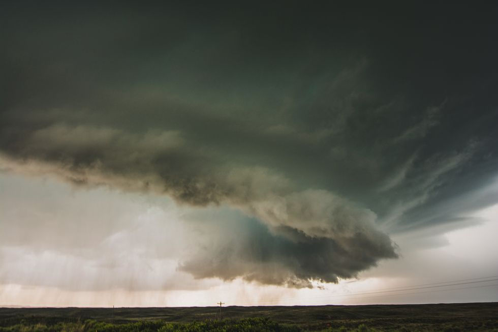 Well defined wall cloud on storm near Canadian, TX May 27, 2015. Notice the rain cooled air...