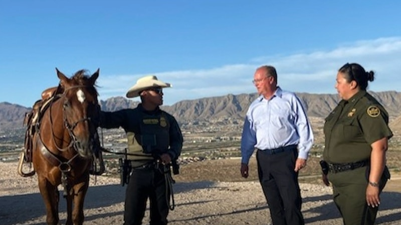 FILE — U.S. Rep. Jim Hagedorn (R-MN), center, speaks with U.S. Customs and Border Protection...