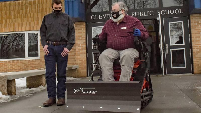 Cleveland school teacher JoelBoehlke tries out his new powered wheelchair as student Ryan...