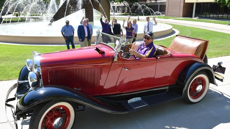 Minnesota State University, Mankato President Richard Davenport sits in his classic car...