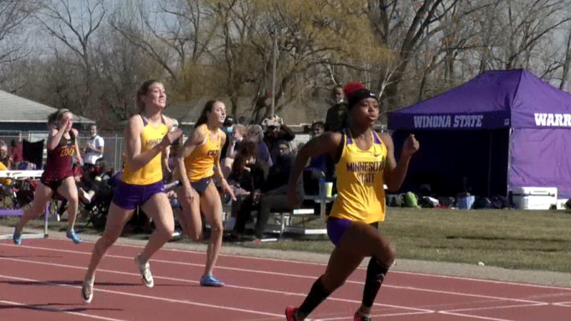 FILE — Denisha Cartwright, right, is pictured sprinting for the Minnesota State Mavericks...