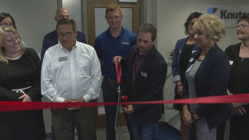 Knutson Construction staff members are pictured at a ribbon-cutting ceremony to open the...