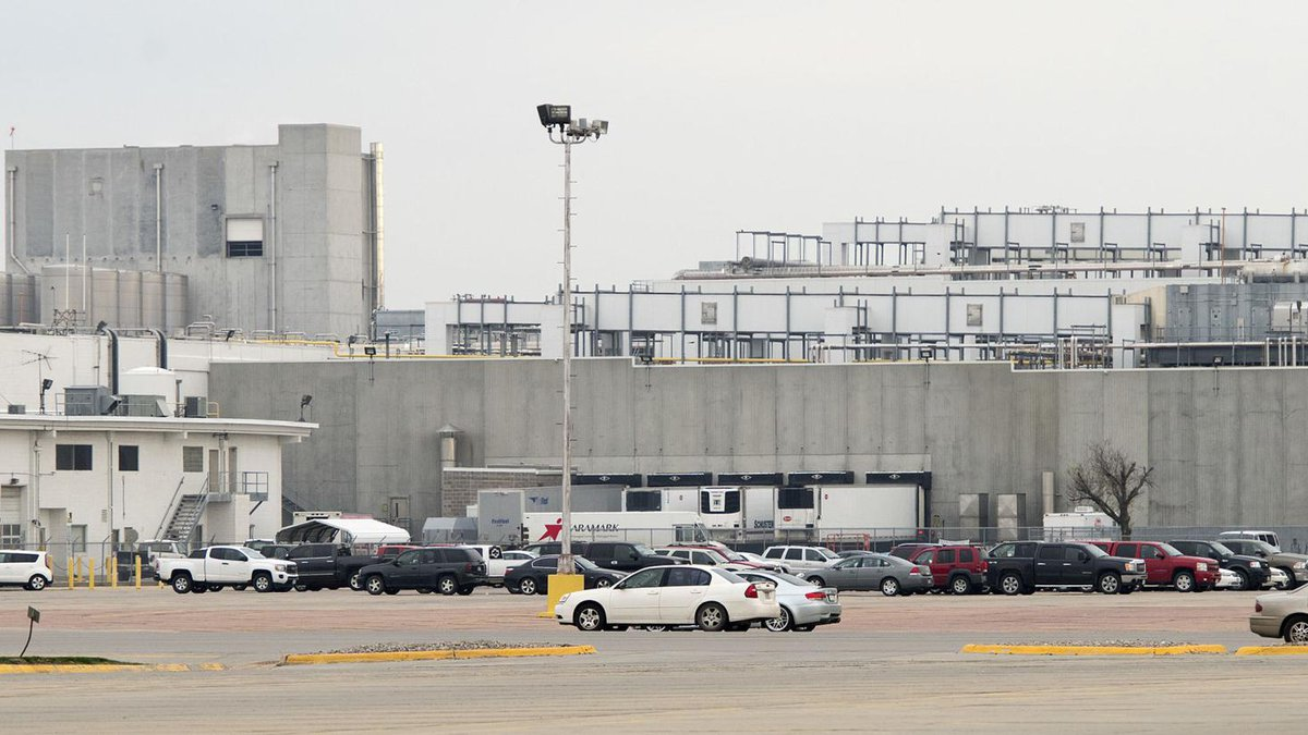 Vehicles are shown in an employee parking lot at the Tyson Foods plant in Dakota City,...
