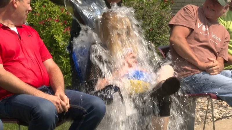 Navitor Specialty Products (NSP) receptionist, Lynn Bartsch gets ice-cold bucket of water...