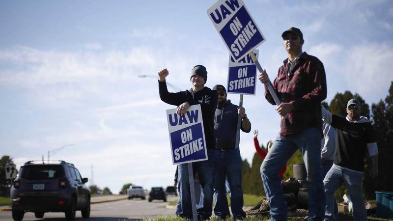 Members of the United Auto Workers strike outside of the John Deere Engine Works plant on...
